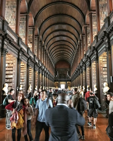 Inside of the Trinity College Library in Dublin, with rows of old books