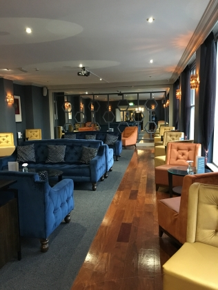 hotel lounge with yellow and blue chairs