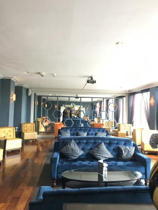 Sandymount Hotel seating lounge area with blue and yellow chairs