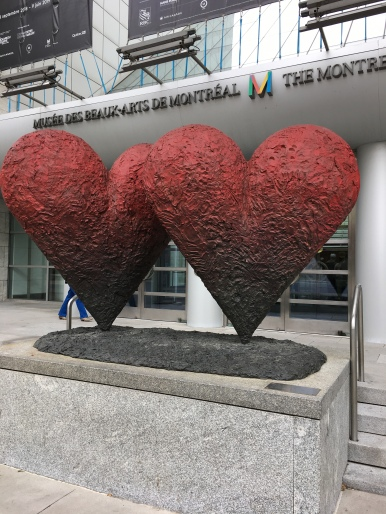 Two large red heart statutes in front of the Museum of Fine Arts