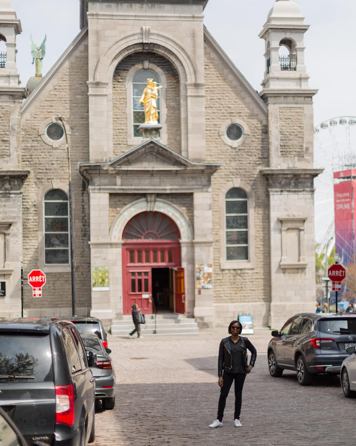 Woman standing in front of Notre Dame Of Bonsecours Chapel