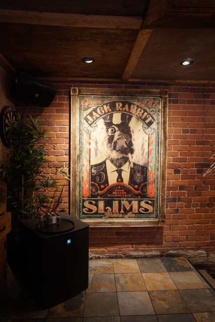 Wall Art is a rabbit in a suit at Warehouse Restaurant in Montreal