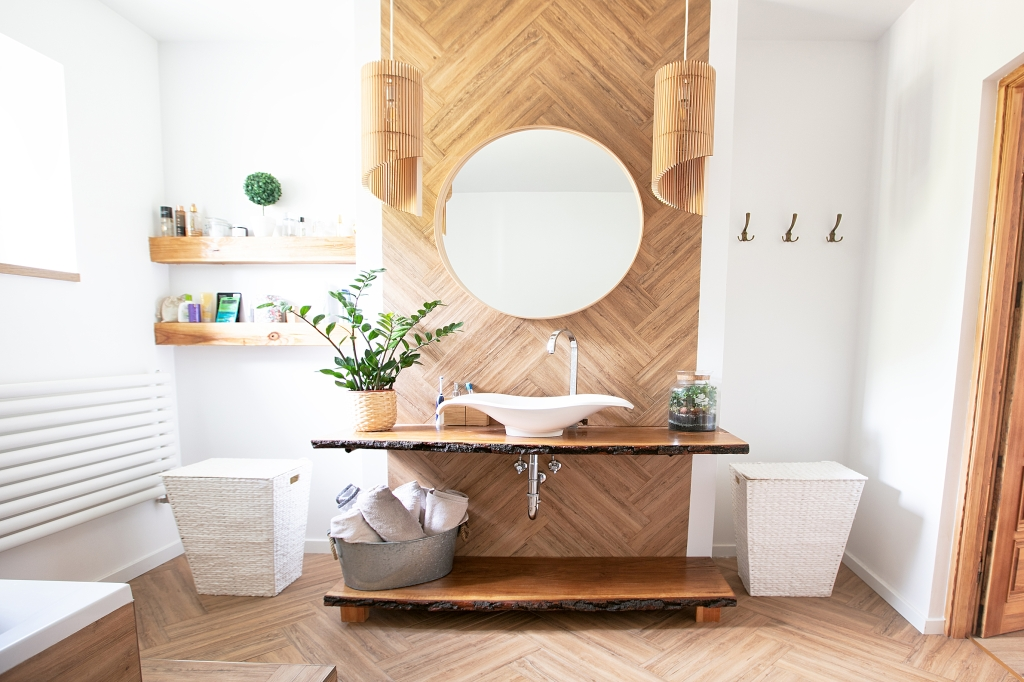 Sleek, clean and modern bathroom with natural wood and white and plants.